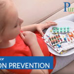 Little child with plate of different pills at home. Household danger